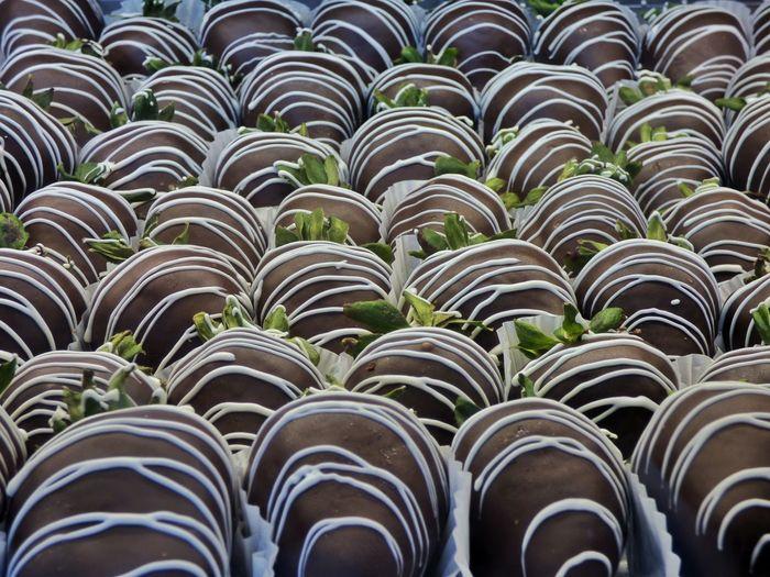 Full Frame Shot Of Chocolate Coated Strawberries