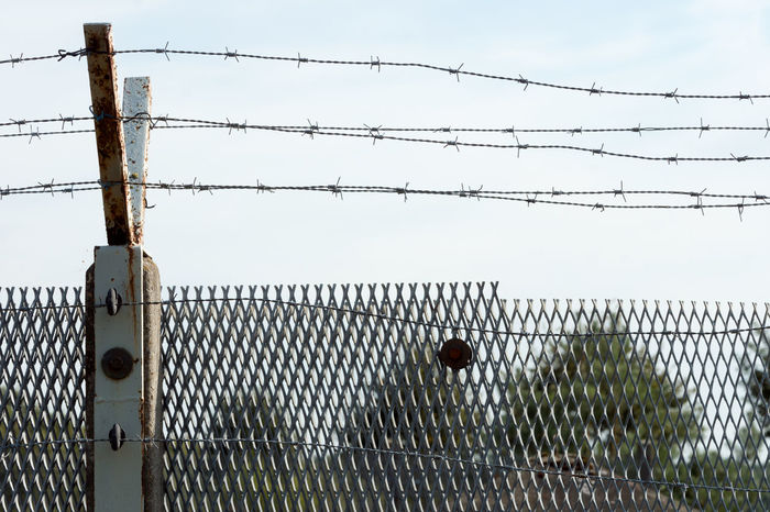 Barbed Wire Barbed Wire Barricade Border Cable Chainlink Fence Change Communist Day DDR East Germany Fence GDR Germany Metal No People Outdoors Prison Protection Safety Security Sky The Wall Wall Wende