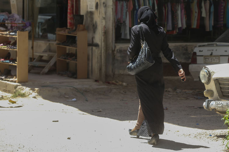 Inside Damascus, SyriaAdult Full Length Headwear People One Person Syria  Damascus  War Girl Street Street Photography Black Dress Midle East Inside Damascus