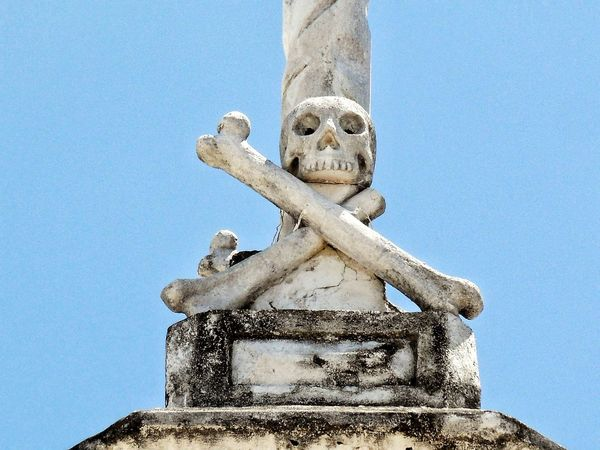 Sepulchral Monuments Tombstone Tomb Monument Skulls And Bones Skull Cemetery Graveyard EyeEm Selects Low Angle View No People Blue Day Sky Outdoors Statue Sculpture Halloween Architecture
