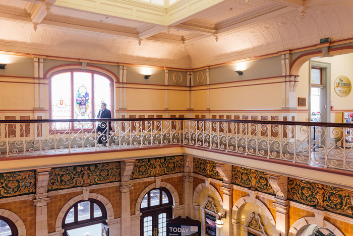 Inside the Dunedin Railway Station Architectural Column Architecture Balcony Banister Day Golden Handrail  Home Showcase Interior Indoors  No People Railing Railway Station