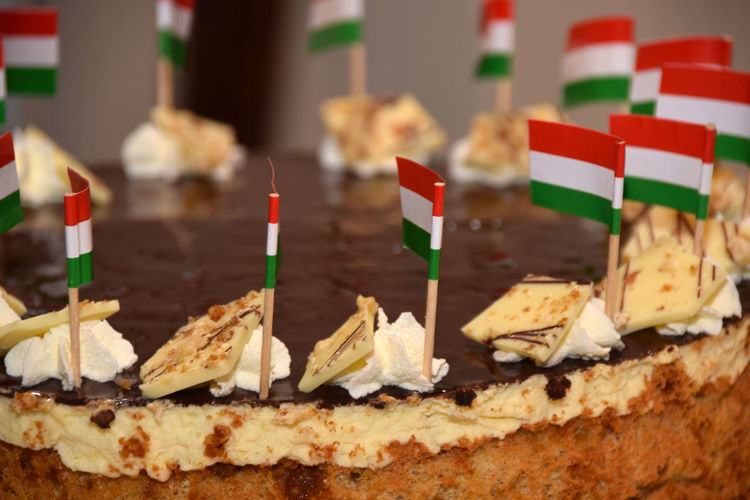 Close-up of small hungarian flags on cake