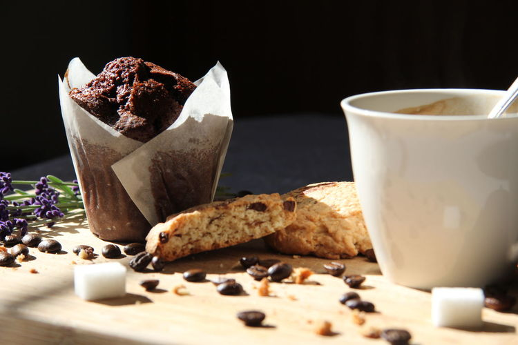 Food And Drink Food Freshness Coffee Sweet Food Cup Coffee - Drink Table Baked Coffee Cup Refreshment Ready-to-eat Cookie Studio Shot Drink Temptation Breakfast Black Background Mug Muffin Chocolate Sugar Lavender Pastry Cafe