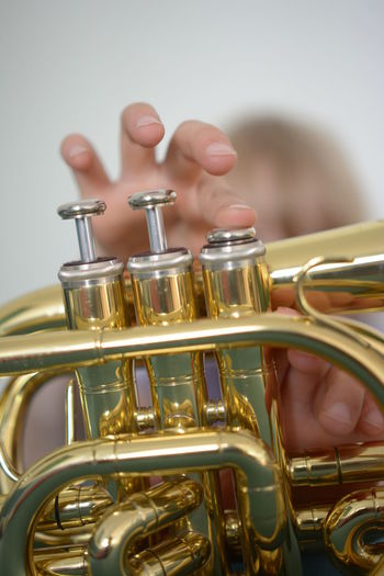 Close-up of hand holding trumpet
