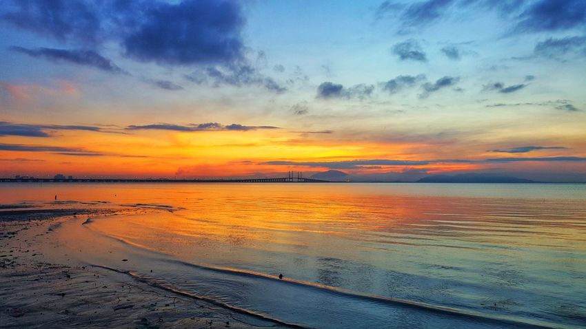 Penang Bridge Penang First Bridge Sunset Beach Water Sea Scenics Orange Color Nature Beauty In Nature Dramatic Sky Sky Reflection Outdoors Cloud - Sky Tranquility Tranquil Scene Horizon Over Water No People Blue Low Tide Wave