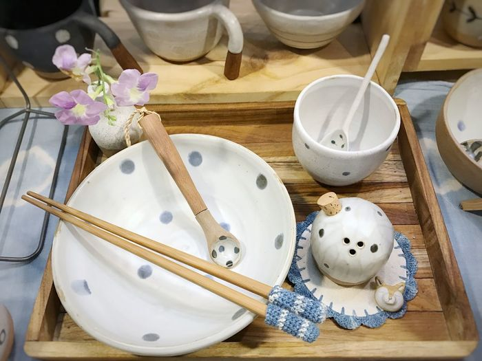 High angle view of crockeries on wooden table
