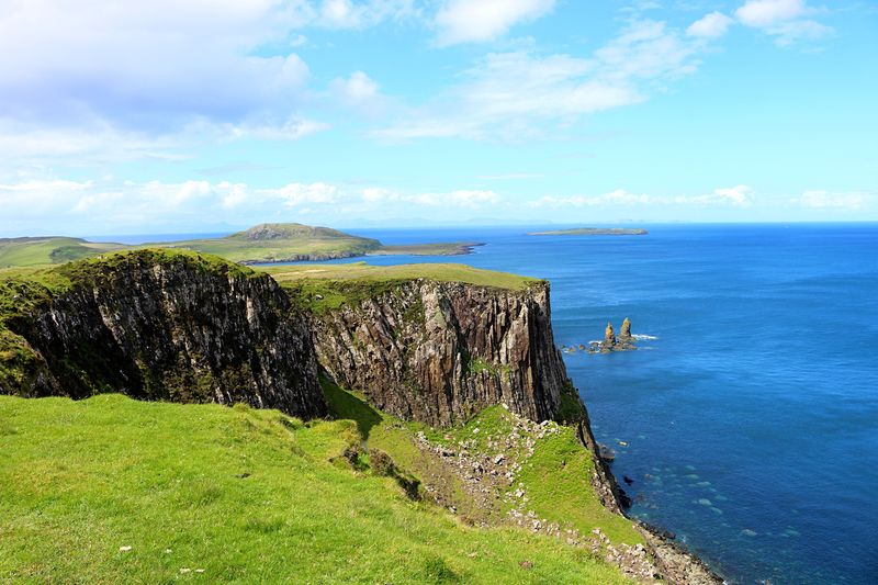 Scenics Beauty In Nature Sky Sea Nature Mountain No People Outdoors Water Grass Green Color Landscape Horizon Over Water Blue Cliff Scotland