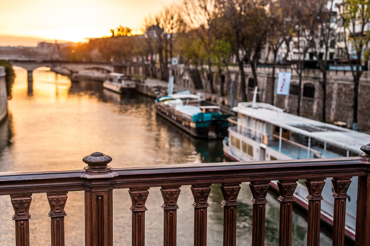 Railing Over River During Sunset