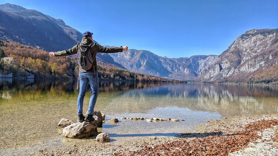 Mountain Mountain Range Nature Sky Adults Only Lake Beauty In Nature Only Men Snow Adult Vacations One Man Only Outdoors Water Scenics Standing Landscape Slovenia Beauty In Nature Travel Destinations Nature EyeEm Selects Day Men People