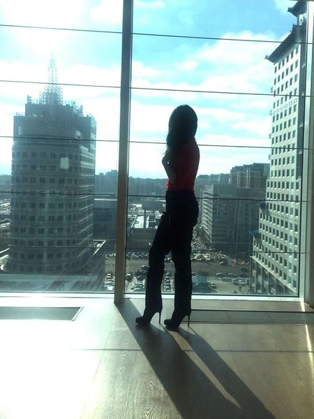 Window Full Length One Person Only Women Rear View Looking Through Window One Woman Only Cityscape City Adults Only Women Adult Businesswoman People Business Office Indoors  Urban Skyline Architecture Skyscraper
