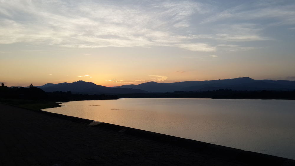 sunset over the dam Beauty In Nature Landscape Mountain Nature No People Outdoors Scenics Silhouette Sky Sunset Tranquil Scene Tranquility Water