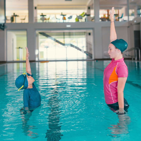 Boy on Swimming Class Swimming Children Swimming Lessons Swimming Class Child Swim Child Swimming Lessons Swimming Pool Swimming Instructor Pool Class Boy Water Fun Activity Cute Blue Childhood Lesson Sport Male Happy Kid Learning People Swimwear Swimming Cap Swimmer Indoors  Physical Activity Young Play Lifestyle Teaching Leasure Photography Caucasian Healthy Action Cheerful Recreational  Recreation  Playful Boys Water Sport Exercise Exercising Female Arm Raised Training