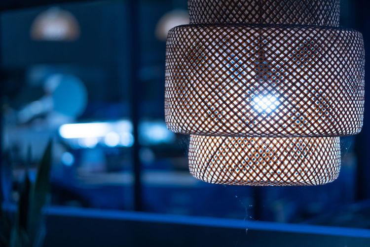 The light from the vintage blue-tone lamps in the restaurant