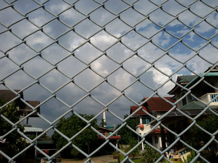 Chainlink Fence Architecture Built Structure Sky Protection Outdoors Tree Beauty In Nature Rainy Days .