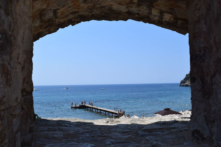 Budva,Montenegro Arch Architecture Beauty In Nature Blue Built Structure Clear Sky Day Horizon Horizon Over Water Montenegro Nature Nautical Vessel No People Outdoors Scenics - Nature Sea Sky Transportation Travel Water