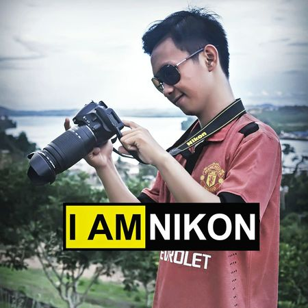 I am Nikon Indonesia Technology Camera - Photographic Equipment Photography Memories Iamnikon Nikon D5100  Nikonphotography Nikonphotographers NikonLife Nikonindonesia Iamindonesia NikonAsia Communication Technology Casual Clothing Connection Person Leisure Activity Holding Text Lifestyles Young Adult Western Script Camera - Photographic Equipment Focus On Foreground