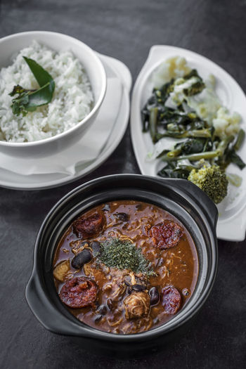 feijoada portuguese meat stew Feijoada Bowl Close-up Day DIP Food Food And Drink Freshness Healthy Eating High Angle View Hummus Indoors  Meat Stew No People Portuguese Food Ready-to-eat Set Meal Stew Table Vegetable