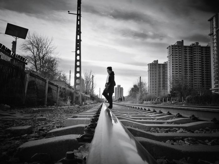 Skyscraper Architecture City Railroad Track The Way Forward Sky Urban Skyline Outdoors Cityscape One Person Street Photography City Life Shadows & Lights Beijing, China Cityscape Shadow Light And Shadow Huawei P9 Photos Black And White Low Angle View Railway Track Mirrored Reflection Walking Cloud - Sky Silhouette