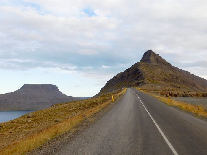 Mountain The Way Forward Road Scenics My Year My View Sky Landscape Cloud - Sky Day Nature Non-urban Scene Outdoors Tranquil Scene Transportation Beauty In Nature Remote No People Mountain Road Winding Road Way Travel Fjords Iceland Traveling Home For The Holidays