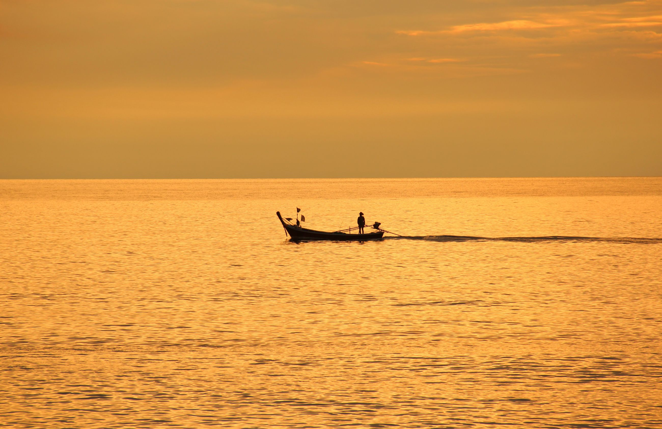 nautical vessel, transportation, sunset, mode of transport, sea, horizon over water, water, boat, waterfront, rippled, silhouette, orange color, journey, scenics, sailing, seascape, tranquil scene, tranquility, beauty in nature, calm, nature, sky, outdoors, ocean, traveling, non-urban scene, tourism, outline
