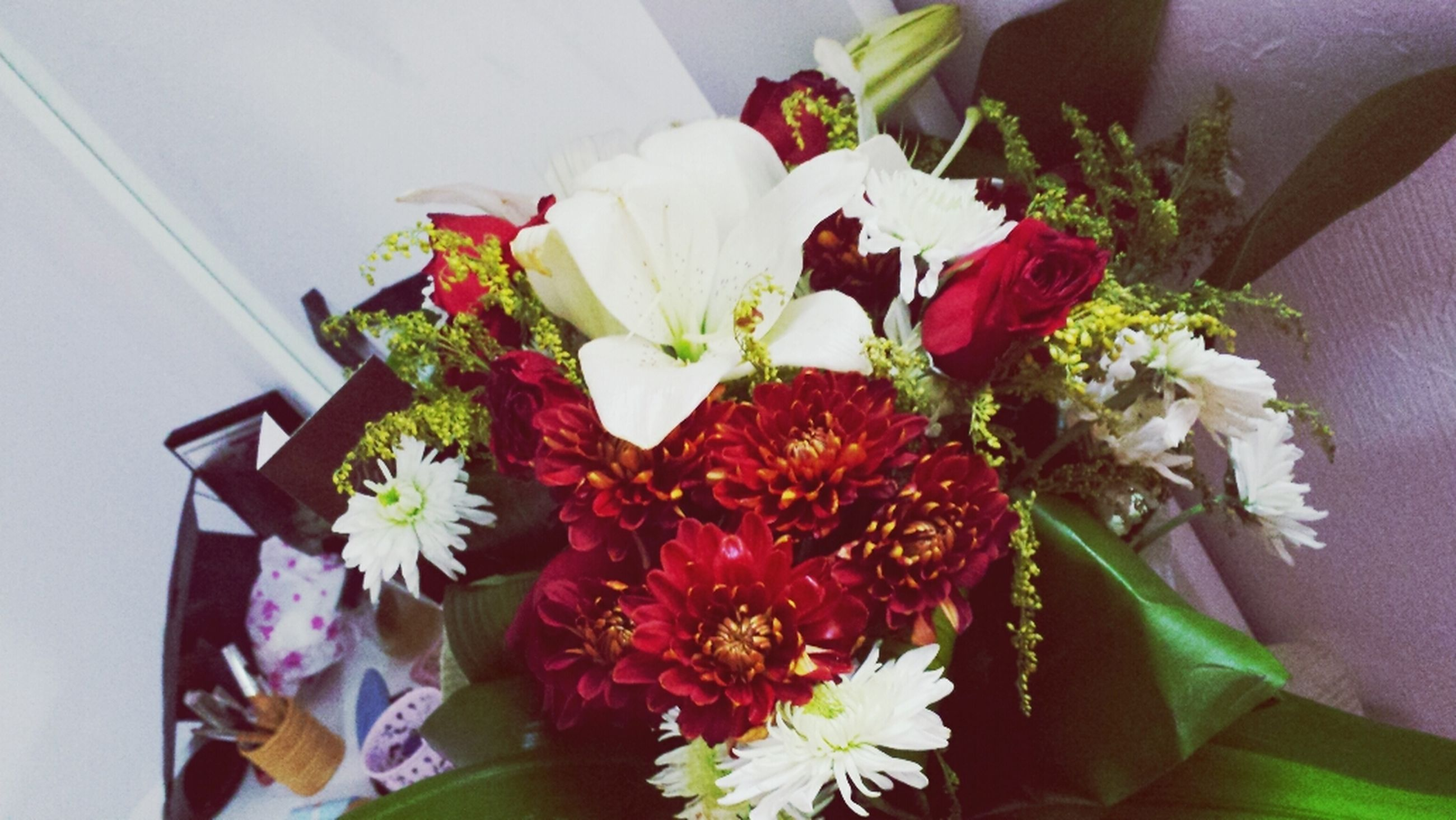 flower, indoors, freshness, petal, fragility, vase, flower head, bouquet, white color, beauty in nature, decoration, flower arrangement, growth, bunch of flowers, potted plant, home interior, plant, high angle view, close-up, nature