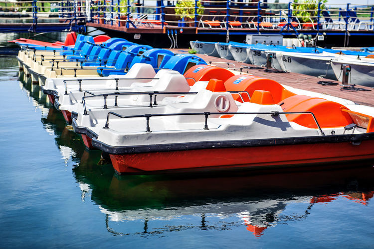 Row of multicolored catamarans Austria Catamaran In A Row Summertime Vacations Vienna Vienna Austria Vienna, Austria Boat Boats Catamaranboat Day Europe Leisure Activity Moored Nautical Vessel No People Outdoors Paddle Paddleboard Summer Water Waterfront
