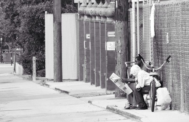 The Street Photographer - 2014 EyeEm Awards Los Angeles, California Reading Newspaper
