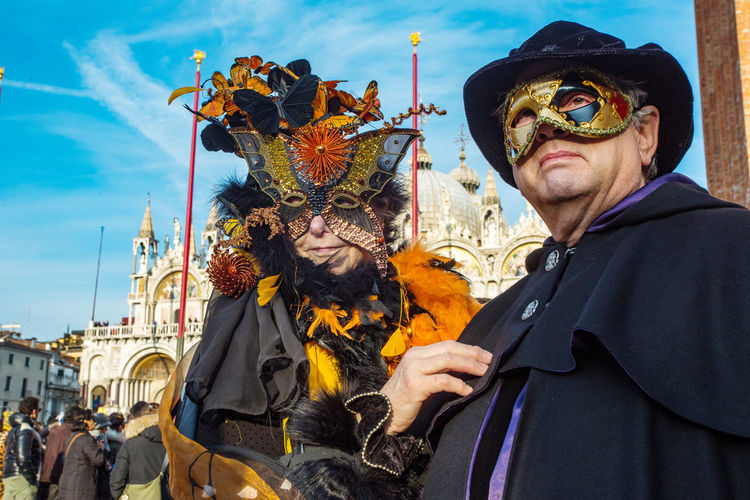 Carnival Carnival In Venice Venice, Italy Adult Adults Only Architecture Building Exterior Built Structure Carnival Costumes Celebration Day Headwear Leisure Activity Lifestyles Mask One Person Outdoors People Real People Sky Standing Venetian Mask