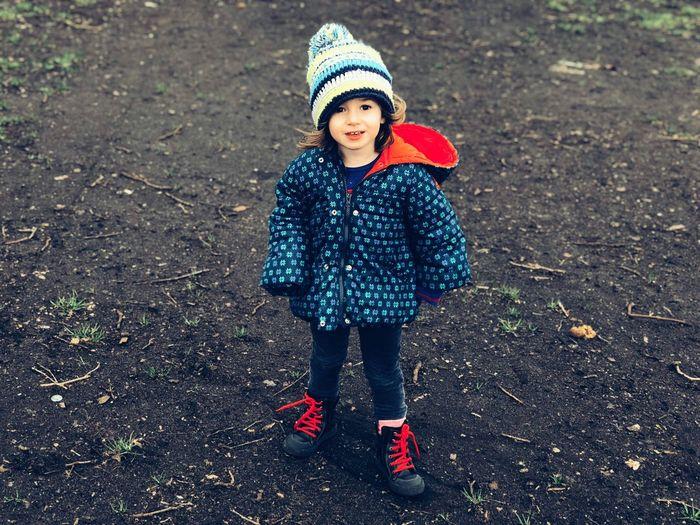 Full length portrait of girl on field