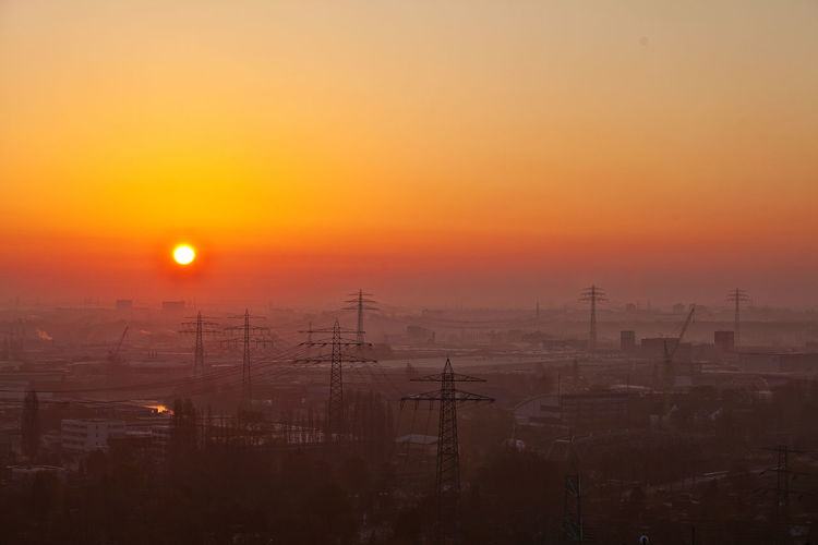 Sunset Sun Sky Orange Color Beauty In Nature No People Electricity  Cable Electricity Pylon Silhouette Nature Technology Scenics - Nature Fog Power Line  Outdoors Environment Fuel And Power Generation Idyllic Power Supply Romantic Sky Hamburg Hamburg Moorfleet