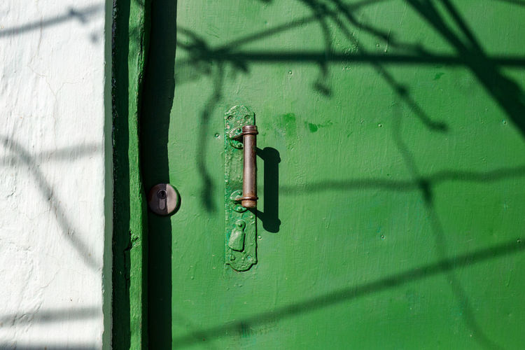 Light Close-up Closed Door Door Handle Door Knob Doorknob Entrance Green Color Handle Knob Latch Lock Old Door Shadow Sunlight