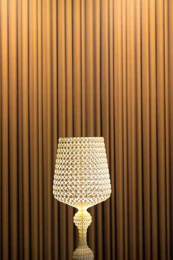 ELegant chandelier against a background of beautiful heavy brown curtains EyeEmNewHere Abstract Art Brown Chandelier Close-up Curtain Curtains Day Design Glass Indoors  Lamp No People Pattern Standing Lamp