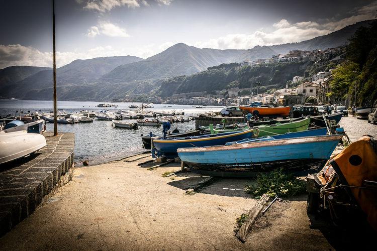 Boats moored at beach