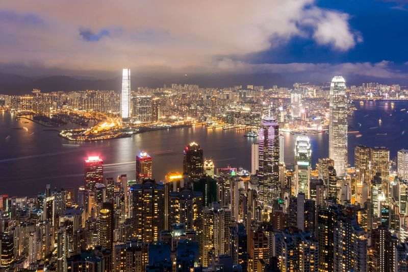 City Architecture Building Exterior Skyscraper Cityscape Sky Illuminated Built Structure Modern Urban Skyline Financial District  Night Tall - High Cloud - Sky Travel Destinations Tower Outdoors No People Downtown District River Landscape Twilight Landmark HongKong Victoria Peak