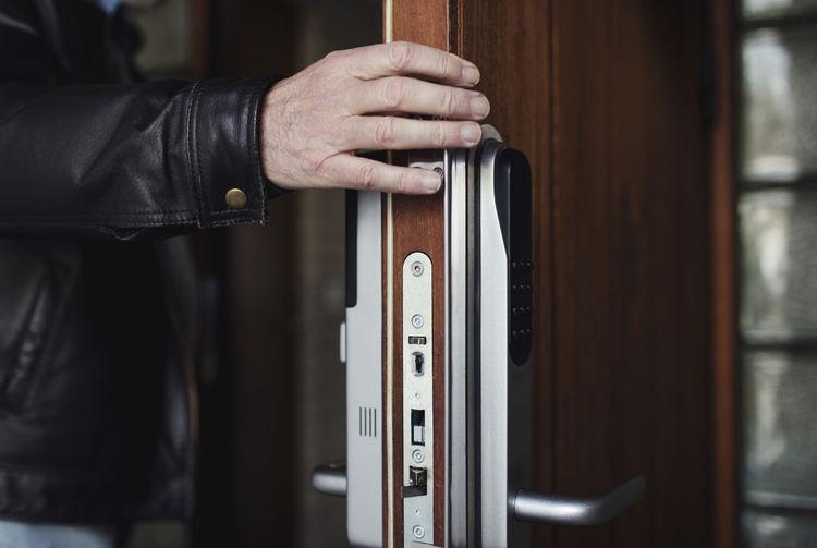 Close-up of man hand holding door