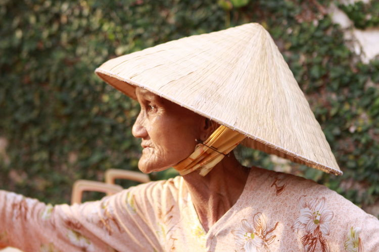 Close-Up Of Senior Woman Wearing Asian Style Conical Hat