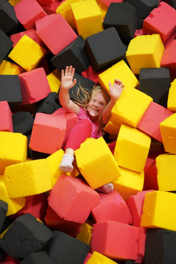 High Angle View Of Girl Lying On Sponges