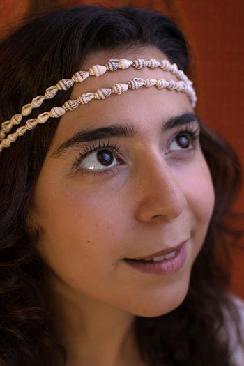 Close-up of woman wearing seashell jewelry
