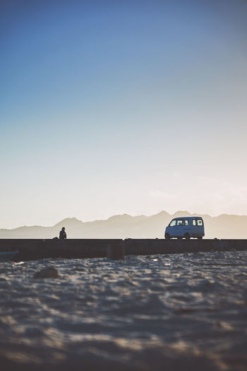 morning light Track Car Silhouette Man Shadow Light Morning Beach Port Mountain Sun Sunlight EyeEm Best Shots EyeEmNewHere EyeEm Nature Lover 沖縄 水納島 Mountain Clear Sky Sunset Sea Water Sunlight Car Road Trip Desert Sky Off-road Vehicle Shore Calm