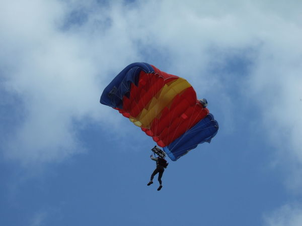 Low Angle View Of Man Paragliding Against Sky Adventure Cloud - Sky Day Extreme Sport Extreme Sports Flying Leisure Activity Low Angle View Low Angle View One Person Outdoors Parachute Paragliding People Real People Sky Skydiving Unrecognizable Person