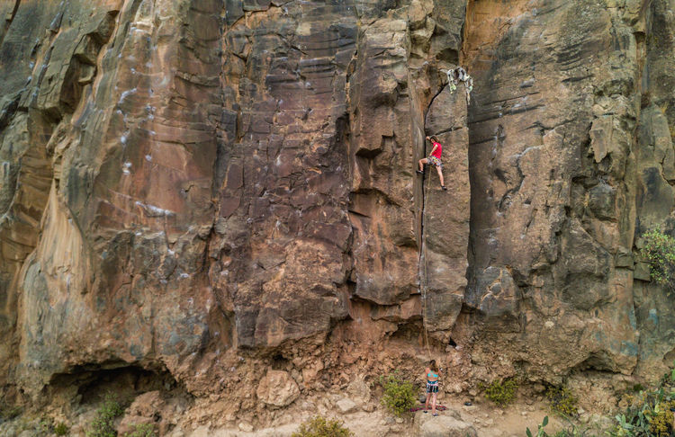 Strong man climbing a rock wall in a canyon Climber Couple Extreme Man Peek SPAIN Top Travel View Woman Activity Adult Adventure Canyon Cliff Climbing Concept Extreme Sports Goal Mountain People Rock Climbing Sport Sports Vacation Go Higher