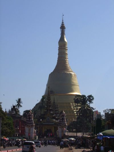 Shwemawdaw Pagoda (Golden God Temple) (374ft tall) Bago Blue Sky Buddhism Buddhist Pagoda Buddhist Religion Buddhist Temple Composition Distant View Famous Place Full Frame Gold Gold Coloured Gold Stupa Low Angle View Myanmar No People Outdoor Photography Pagoda Place Of Worship Place Of Worship Religion Spirituality Tourist Attraction  Tourist Destination Tree