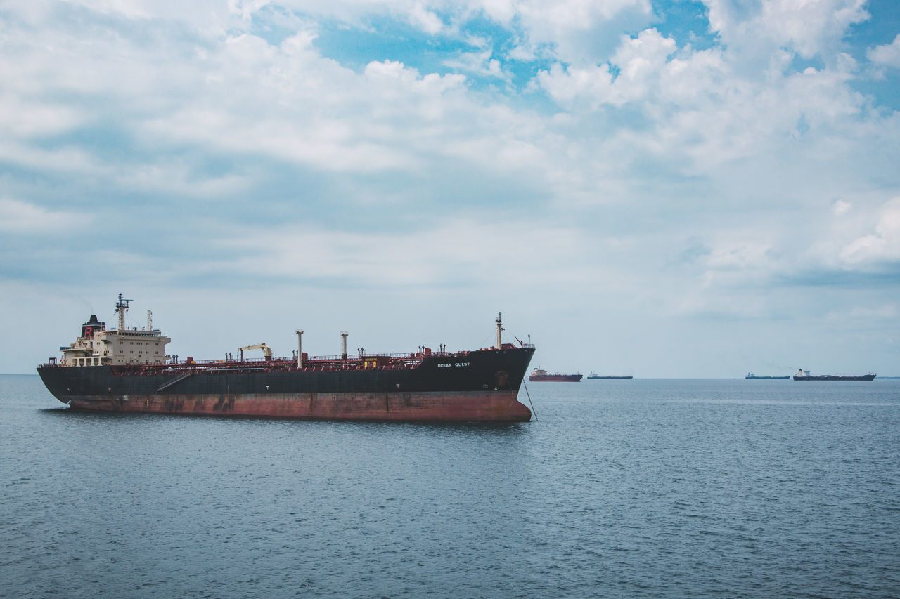 water, sea, nautical vessel, transportation, cloud - sky, waterfront, mode of transport, day, sky, ship, no people, freight transportation, nature, outdoors, tranquility, scenics, beauty in nature, offshore platform, drilling rig