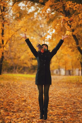 Full Length Happiness Autumn Young Adult Human Limb Human Arm Limb Rear View Adults Only Outdoors Arms Raised Smiling Tree Standing Adult Only Women Grass Change Nature Beauty Jump Jumping Autumn Nature Park