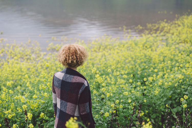 Beauty In Nature Curly Hair Day Field Flood Flooded Flower Girl Growth Lake Kaweah Leisure Activity Nature One Person Outdoors Plant Real People Rear View Scenics Standing Water Yellow Young Adult Young Women Paint The Town Yellow