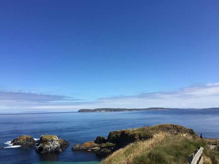 Day Trip View Exploring Hiking Ballintoy Northern Ireland Carrick-a-Rede Rope Bridge Travel Noedit Nofilter Water Sea Scenics - Nature Sky Beauty In Nature Tranquility Blue Tranquil Scene Nature Land Day No People Plant Idyllic Non-urban Scene Rock Outdoors Tree