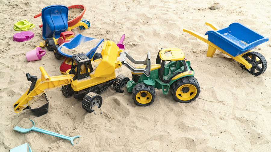High angle view of toys on sand