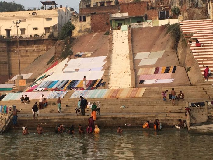 Indian lifestye and culture in Varanasi along the Ganges River. Buring Ghats, Seagulls Around Boats, Mother Ganges River, Sunrise At Ganges In Varansi Holy Men, Bathing In River, Boats In River, Banares, India Varanasi, India Ganges, Indian Lifestyle And Culture, Bathing In The Ganges,