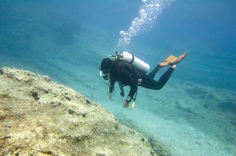 Woman scuba diving in sea