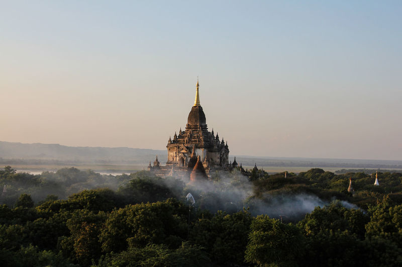 Ancient Architecture Building Exterior Built Structure City Cultures Day Fog History Landscape Morning Myanmar No People Outdoors Place Of Worship Religion Scenics Sky Spirituality Sunset Tourism Travel Travel Destinations Tree Vacations